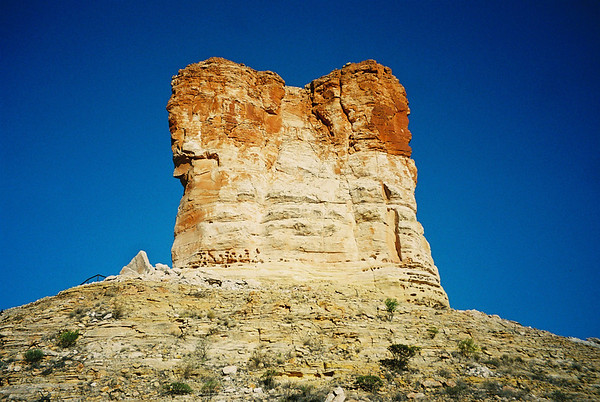 Chambers Pillar, The main feature of this 340 hectare Reserve is the pillar of sandstone which towers 50 metres above the surrounding plain. Sandstone deposits were laid down in the area 350 millions years ago. Since then, wind and rain have eroded away the softer material, leaving this solitary column of pebbly sandstone. <br /> <br /> John MacDouall Stuart, heading north on his earliest attempt to cross Australia, first recorded the pillar in April 1860 and named it after James Chambers, one of his South Australian sponsors.