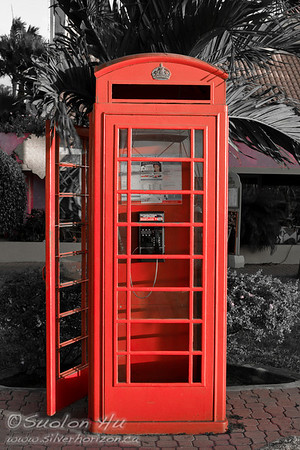 A telephone booth in Oranjestad, Aruba (red)