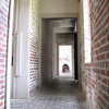 Corridors All Around Perimeter of the House - Atalaya at Huntington Beach State Park, Murrells Inlet, SC  3-26-11<br /> Living facilities, including the dining room, library and the master bedroom, occupied the ocean side of the house.  The southern wing housed Archer's study, his secretary's office and Anna's indoor and outdoor studios.  The northern wing housed the kitchen complex and the servants' living area.  The rooms were heated entirely by wood fireplaces and coal stoves.