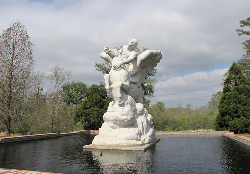 Pegasus, Laura Gardin Fraser (1889-1966), Granite, 1946-1954 - Brookgreen Gardens, Murrells Inlet, SC  3-25-11<br /> The largest sculpture at Brookgreen also took the longest to create.  It was nearly nine years from the inception to completion.  A stone carver under the supervision of the sculptor carved the sculpture in Mt. Airy granite.  For 4 years the carver worked at Brookgreen on the stone in order to complete the job.  Pegasus, the winged horse of mythology, is an ancient symbol of inspiration.  The sculptor designed this work to symbolize the person born with vision and imagination who soars with Pegasus.
