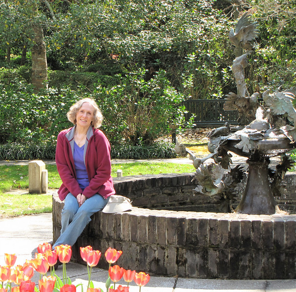 Donna at Peace Fountain - Brookgreen Gardens, Murrells Inlet, SC  3-25-11 Peace Fountain, Sandy Scott (b. 1943), Bronze, 1996 - The presentation of birds in flight and its many possibilities has always intrigued Sandy Scott as a sculpture theme.  Scott believes that her knowledge of aerodynamics, a result of more than 25 years as a licensed pilot, has been helpful in achieving the illusion of movement in her award-winning sculpture of birds.