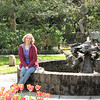 Donna at Peace Fountain - Brookgreen Gardens, Murrells Inlet, SC  3-25-11<br /> Peace Fountain, Sandy Scott (b. 1943), Bronze, 1996 - The presentation of birds in flight and its many possibilities has always intrigued Sandy Scott as a sculpture theme.  Scott believes that her knowledge of aerodynamics, a result of more than 25 years as a licensed pilot, has been helpful in achieving the illusion of movement in her award-winning sculpture of birds.