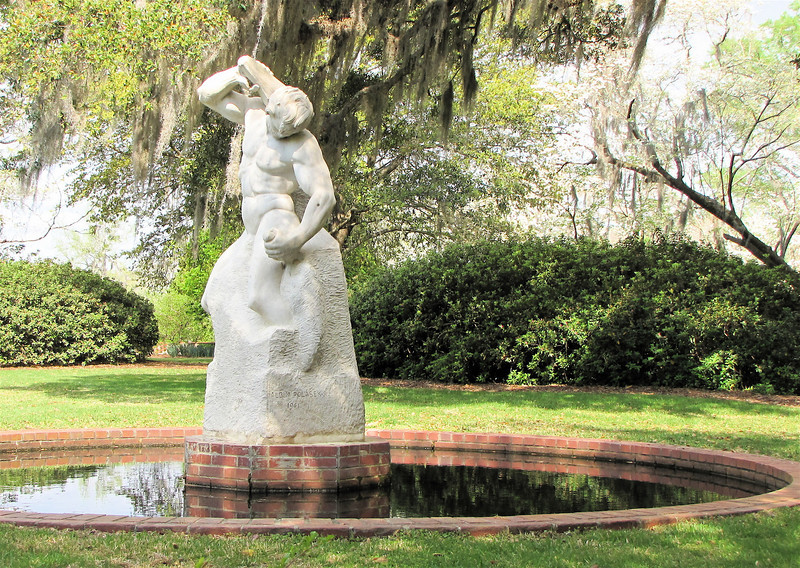 """Man Carving His Own Destiny, Albin Polasek (1879-1965), Indiana Limestone, 1961 - Brookgreen Gardens, Murrells Inlet, SC  3-25-11<br /> This sculpture, first created when he was a student at the Pennsylvania Academy of Fine Arts, so haunted Polasek that he continually revised and refined the concept.  The different versions expressed his personal vision of """"man chiseling himself, struggling to hack out his own character, carving his future by the effort of his will.""""  <br /> How difficult a life it is if you have to live it out of your own will, rather than God's will."""