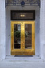 Gold door on commercial building in Savannah Georgia.