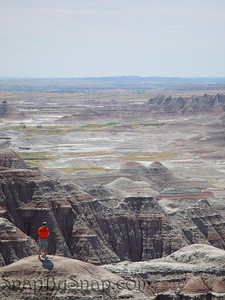 A men enjoying the rugged landscape of Badlands National Park.