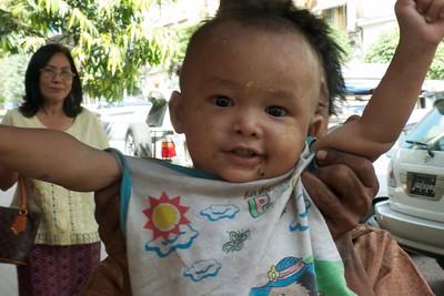 A happy boy seen in downtown Yangon.