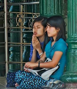 Two young girls praying.