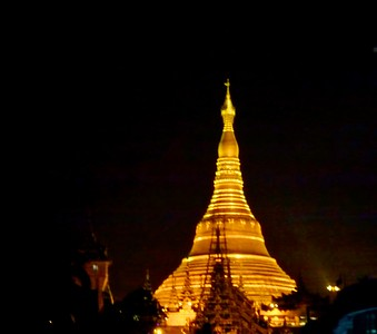 Night time view of the Shwedagon Pagoda, AKA the Golden Pagoda.  It is the most sacred pagoda Myanmar because it houses relics of the past four Buddhas -- the staff of Kakusandha, the water filter of Konagamana, a piece of robe of Kassapa, and eight hairs of Gautama (the historical Buddha.)
