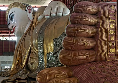 This was our stop in Yangon.  The Chaukhtatgyi Reclining Buddha which is over 200 feet long.  Note the crown which is encrusted with diamonds and other precious stones.