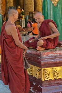 Two monks within the Golden Pagoda complex.