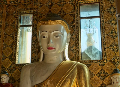 One of the many buddha statues within the Shwedagon pagoda complex.