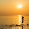Stand-up paddling at sunset