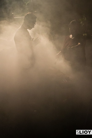 Bathed in smoke at a Balinese grill in Indonesia.