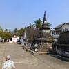 A temple complex (wat), with a stupa (aka pagoda, a tomb really)