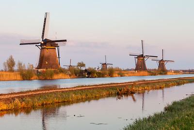 Windmills near Kinderdijk at sunset, South Holland, Netherlands