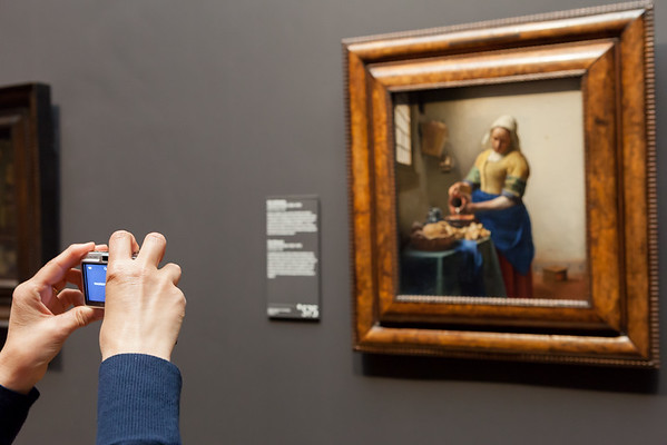 """Admirer of famouse painting """"The Milkmaid"""" from Johannes Vermeer, ca. 1660, Rijks museum, Amsterdam, Netherlands"""