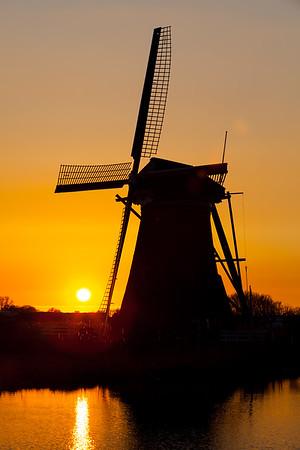 Silhouette of windmill near Kinderdijk at sunset, South Holland, Netherlands