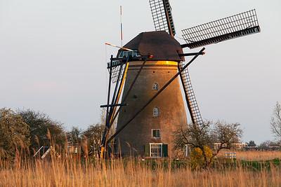 Windmill near Kinderdijk at sunset, South Holland, Netherlands