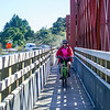 Lesley on cycle bridge attached to the one lane bridge across the Taramakau