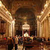 Rome (Trastevere) - interior of Santa Maria in Trastevere Church, with some of the people from evening worship.