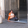 "Rome (Trastevere) - the entrance to the Church, with one of the ubiquitous beggars waiting for ""donations""."
