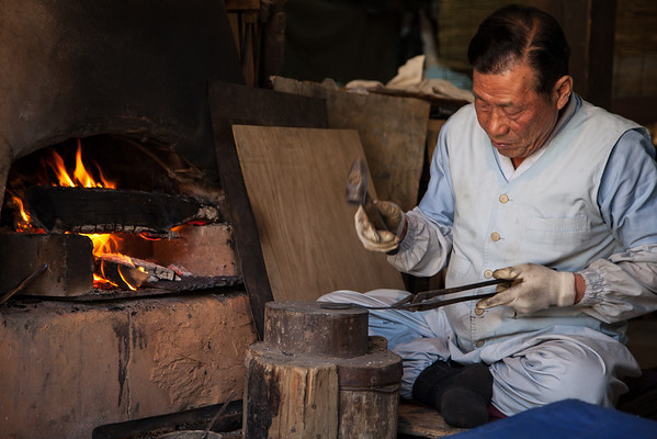 One of the twin brothers making spoons at the Korean Folk Village in Yongin, South Korea.