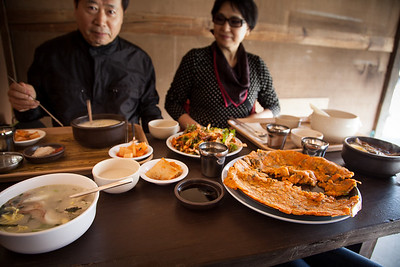 Eating (L-to-R) duk manduguk, seolleongtang, muk, kimchi jeon, and yukgaejang.