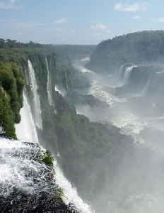 "The name of the falls comes from the Guaraní word for ""great water."" The first Spanish explorer to see the falls (did you see the film The Mission?) was Álvar Núñez Cabeza de Vaca in 1541 but the vast power of the falls was not fully utilized until the construction of the huge Itaipu hydroelectric power plant built jointly by Paraguay and Brazil. Completed in 1991 the dam is open to tours and provides 12,600,000 KW of power satisfying almost 40% of Brazil and Argentine power needs. The dam one of the largest in the world is touted by both countries as a masterpiece of technology."