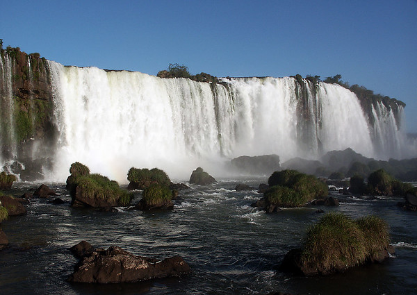 Iguazú Falls, called Foz do Iguaçu in Brazilian, and Cataratas del Iguazú in Spanish, lie on the Argentina - Brazil border and are a UNESCO World Natural Heritage Site.
