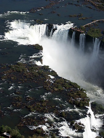 """Devil's Throat"". During the rainy season of November - March, the rate of flow of water going over the falls may reach 450,000 cubic feet (12,750 cubic m) per second."