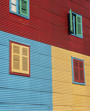 The streets and bright colorful houses of La Boca neighborhood are unmistakable.