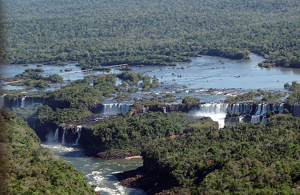 Taller than Niagara Falls, twice as wide with 275 cascades spread in a horsehoe shape over nearly two miles of the Iguazu River, Iguazú Falls are the result of a volcanic eruption which left yet another large crack in the earth.