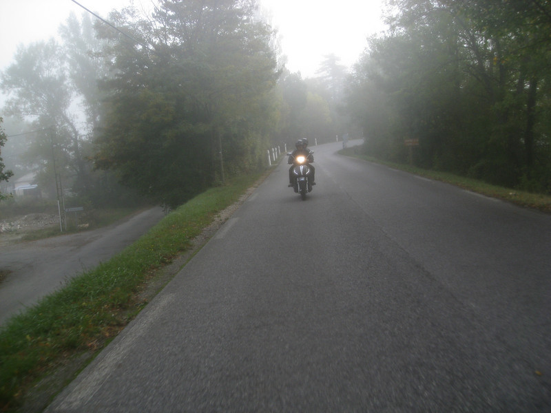 Coming into a mountain town with the morning mist.