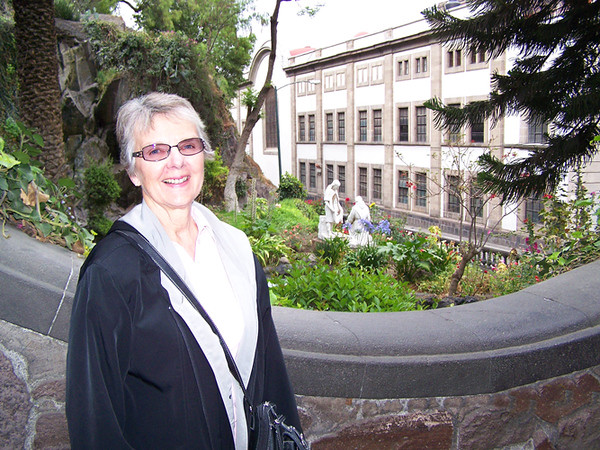 Shirley stops on the garden steps to the hilltop church of Guadalupe. April, 2009. Shared by Vern.