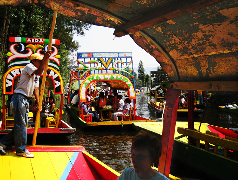 Cruising the party section canal at the Xochimilco Floating Gardens. Tricia packed a picnic lunch that we enjoyed at a long table on the boat. Our poler is on the left and Jody in the foreground. April, 2009.