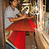 This young man is demonstrating weaving on a large floor loom. Mexico produces a lot of textiles and we did our part to take some off their hands. April, 2009.