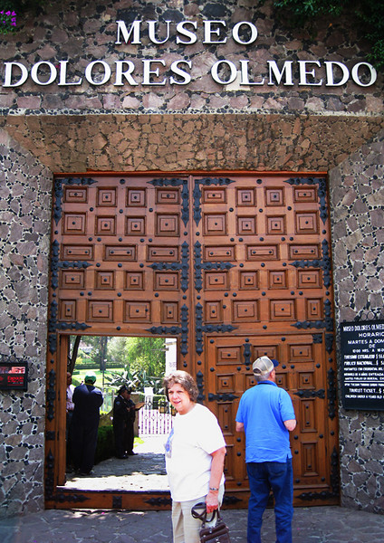 "Claudia and Vern at the entrance of the Museo Dolores Olmedo. She was a ""friend"" of Diago Rivera and knew Frida Kahlo. Dolores had a rags to riches life, making her income in the brick manufacturing business. April, 2009."