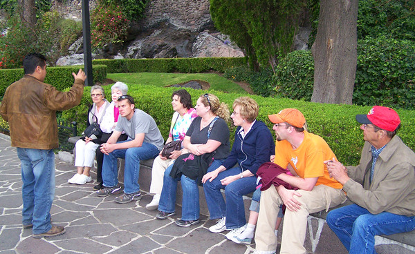 Filipe tells us the story of the Virgin of Guadalupe near the monument. April, 2009. Shared by Vern.