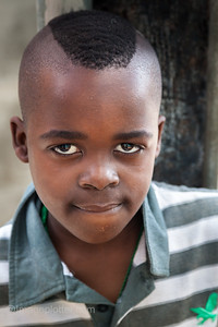 Young Boy Showing off his New Haircut, Imizamo Yethu Township (Mandela Park), Cape Town, South Africa