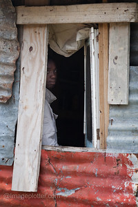 Boy looking out through Window, Imipamo Yethu Township (Mandela Park), Cape Town, South Africa