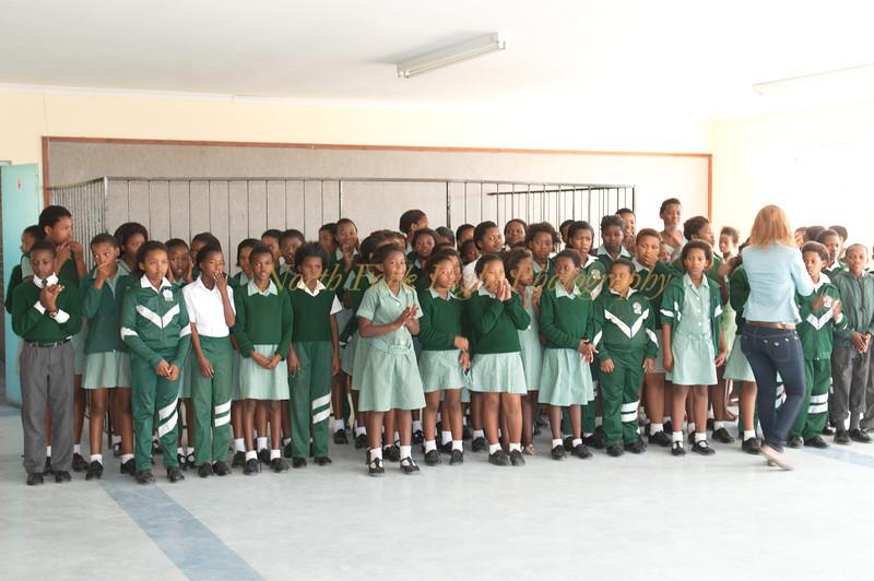 We visit a local school where children entertain us.