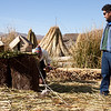 Demonstrating the construction of a floating reed island (Lake Titicaca)