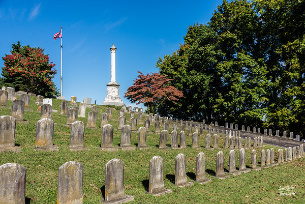 Confederate soldiers buried in Cave Hill Cemetery.  Note the condition of the Confederate graves seem much more aged and deteriorated.