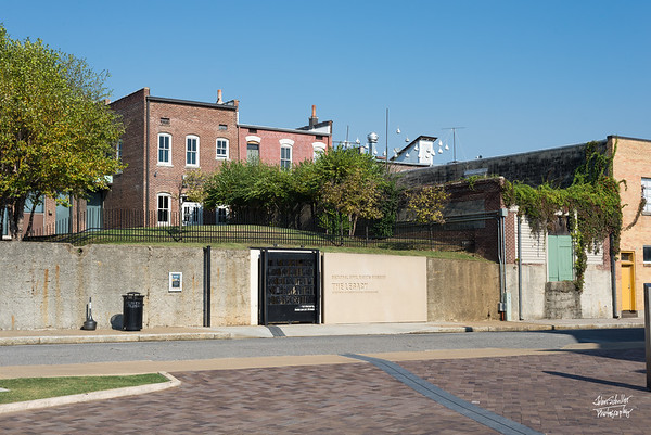 Across the street from the Lorraine Motel, up on the hill above the runnel entrance is the boarding house from where James Earl Ray shot Dr. King.