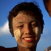 Burmese boy with sandalwood paste on his face. They use this for sunscreen.