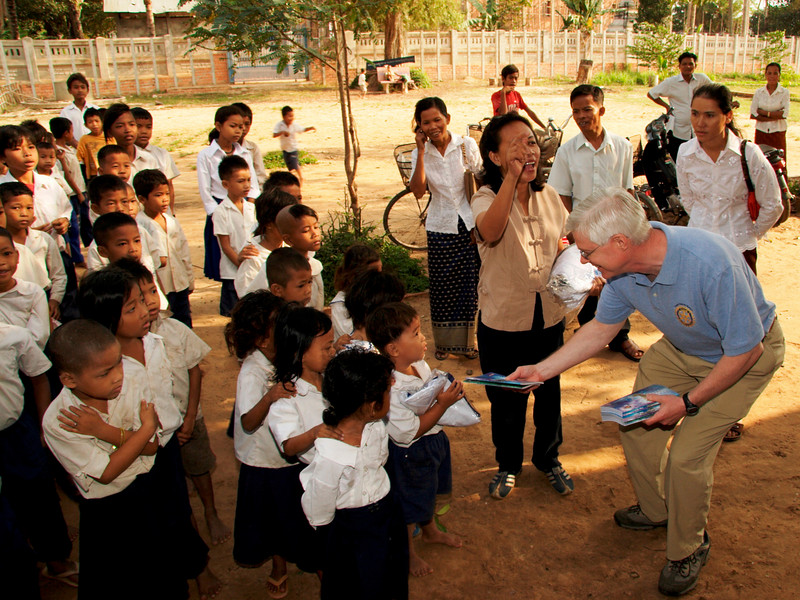 Craig hands out school suppies to the kids - Vat Kong Moch School, Siem Reap