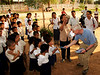 Craig hands out school suppies to the kids - Vat Kong Moch School, Siem Reap