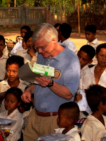 Craig hands out school supplies to the kids - Vat Kong Moch School, Siem Reap
