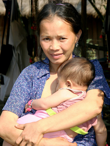 Mother and child at Me Kong River village near Luang Prabang