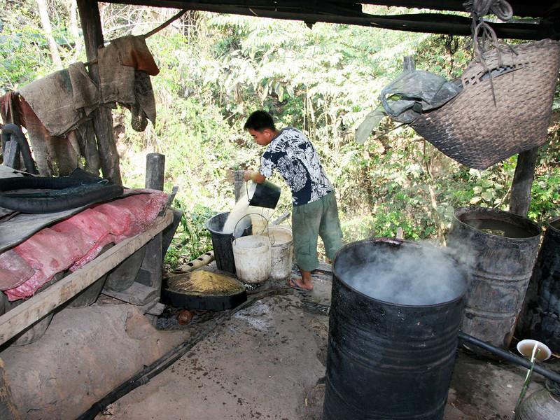 Making whiskey at a Me Kong River village near Luang Prabang